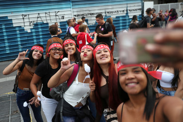 "Women take a selfie as they wear headbands that's read;""Free Lula"" during a general strike against the government's pension plan and cuts to federal spending on higher education planned by Brazil's President Jair Bolsonaro's government in Sao Paulo"