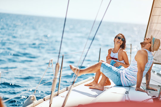 Smiling lovers relaxing on a luxury yacht. couple on cruise..