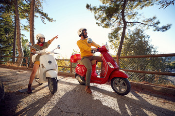 Happy couple traveling on motorcycle and looking at Italy on vacation..