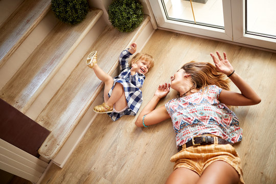 Babysitter with child having fun