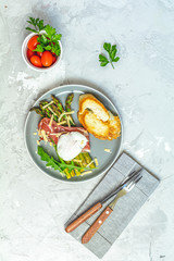 Green asparagus and boiled poached egg