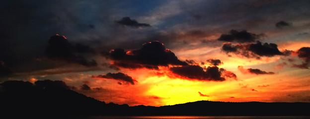 Stormy dark stratocumulus cloud in a bright sunset sky.
