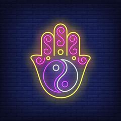 Yin yang on hamsa hand neon sign. Meditation, balance, tao design. Night bright neon sign, colorful billboard, light banner. Vector illustration in neon style.
