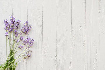 Keuken foto achterwand Lavendel Composition of lavender on white wooden background. Violet summer flowers. Free space