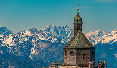 Beautiful alpine view with the famous chapel Heilig Kreuz at the Wallberg near Tegernsee - Bavaria - Germany Wall mural