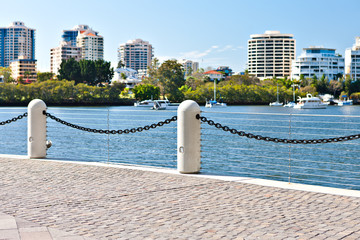 Modern riverside concrete pillar fence that attached with steel chain