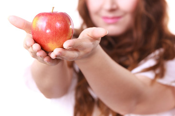 Woman holds red apple, focus on fruit
