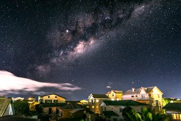 Milky way above rooftops of Southern Antananarivo, the capital of Madagascar.