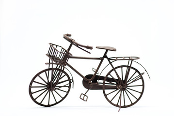 Miniature bicycle on white background.