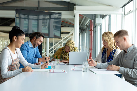 Business people working together in meeting room in a modern office