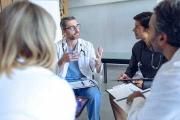 Medical team discussing with each other in hospital