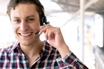 Male customer service executive talking on headset in office