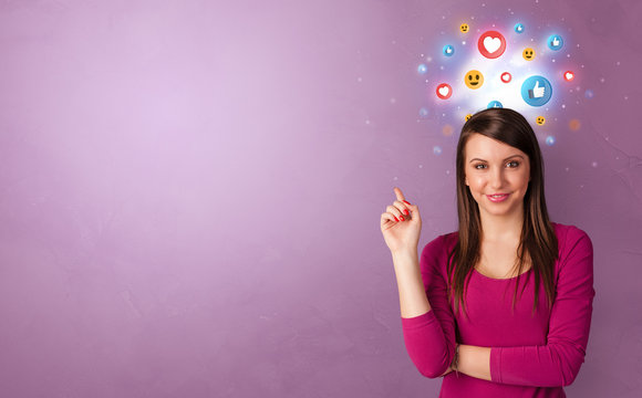 Business person standing with social media and emoticons concept