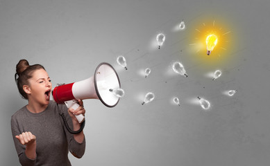 Person talking in megaphone with bulb, new idea concept