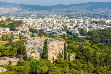 Fototapete - Panorama of Athens from the Acropolis, Greece. Areopagus rock with people in foreground. It is one of the main tourist attractions of Athens. Scenic view of the Athens city. Urban landscape in summer.