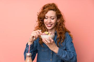 Happy Redhead woman having breakfast
