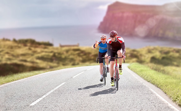 Cyclists out racing along country lanes near the coast in the United Kingdom