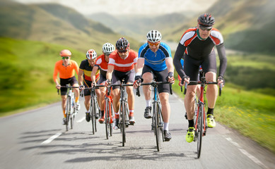 Cyclists out racing along country lanes in the mountains in the United Kingdom. Wall mural