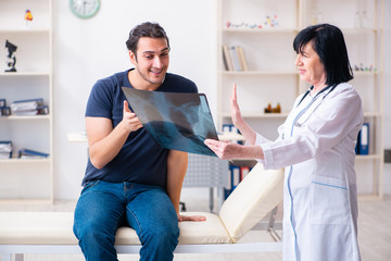 Young male patient visiting aged female doctor