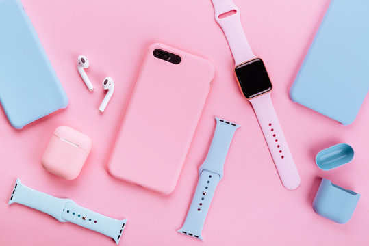Up to date technology.Top view of diverse personal accessory laying on the pink background