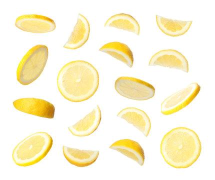 Set of flying cut fresh juicy lemon on white background