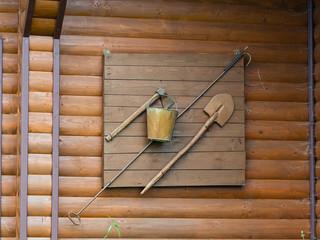 retro old fire fighting equipment axe, shovel, bucket.  Still used