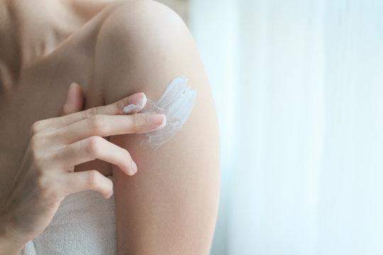 Woman applying arm cream,lotion , Hygiene skin body care concept.