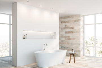 White and stone bathroom corner with tub