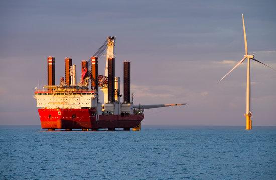 Specialised jack up ship MPI Adventure erecting offshore wind farm near Coatham, Redcar, England