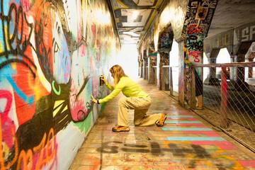 Spray Painting Graffiti in Krog Street Tunnel, Atlanta, Georgia