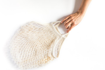 Cotton eco mesh bag on white background. Eco-friendly concept Wall mural
