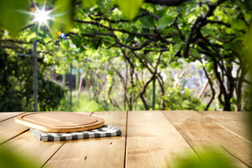 Fototapete - Summer desk of free space and green garden background