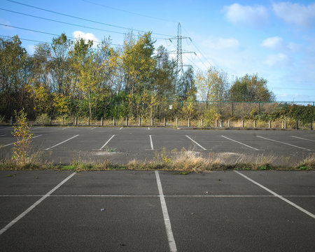Abandoned car park of steelworks, now closed, UK