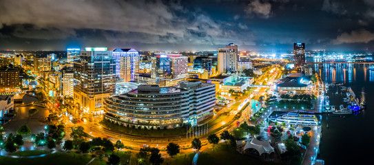 Aerial panorama of Norfolk Virginia by night. Norfolk is the second-most populous city in Virginia after neighboring Virginia Beach and the host of the largest navy base in the world.