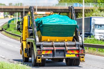 Fototapeta skip lorry truck on uk motorway in fast motion obraz