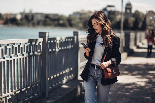 Fashion Portrait of Stylish Pretty Brunette Young Woman Outdoor