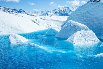Canyons of ice flooded with bright blue ice of the melting Matanuska Glacier.