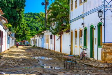 Wall Mural - Street with tables of cafe in historical center in Paraty, Rio de Janeiro, Brazil. Paraty is a preserved Portuguese colonial and Brazilian Imperial municipality