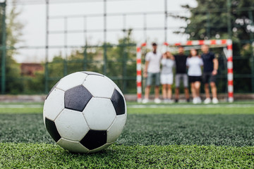 Traditional soccer ball on soccer field. Close up photo..
