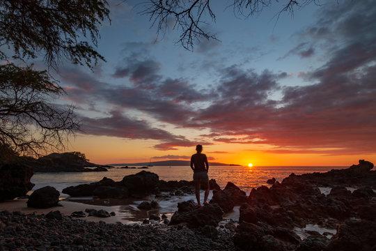 Woman watching sunset at Makena Bay, Maui, Hawaii, USA
