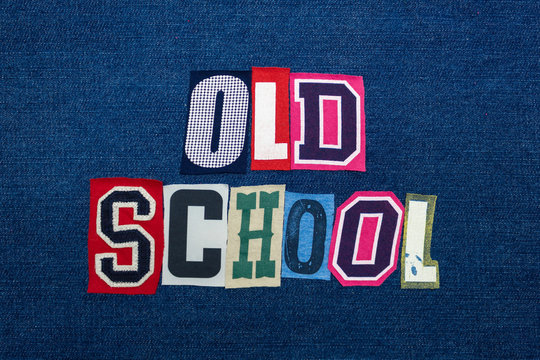 OLD SCHOOL collage of word text, multi colored fabric on blue denim, pre technology vintage concept, horizontal aspect
