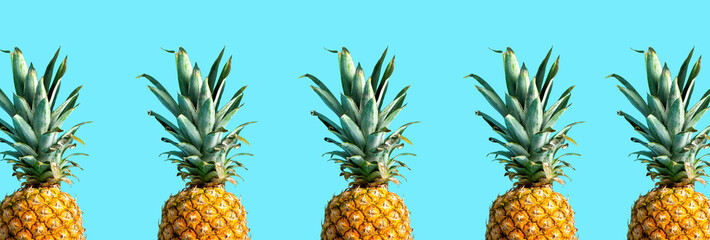Many pineapples on a solid color background Wall mural