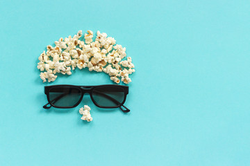 Abstract image of viewer, 3D glasses and popcorn on blue background. Concept cinema movie and entertainment Flat lay Top view Copy space Template for text or your design