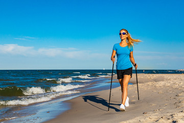 Nordic walking - young woman training