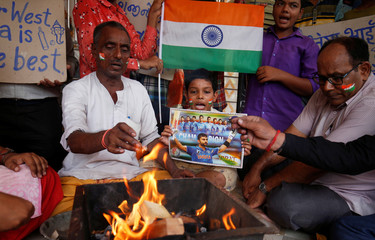 Fans offer special prayer for the victory of the Indian cricket team before the start of their one-day international match against Pakistan during the ICC world cup, inside a temple in Ahmedabad