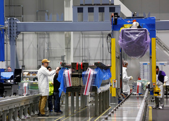 Employees prepare to begin work on a new set of 777X composite wing panel stringers during a media tour of the Boeing 777X Composite Wing Center at the Boeing production facility in Everett