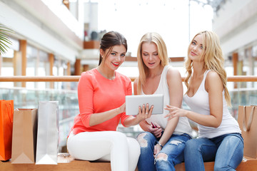 Girls with tablet in mall