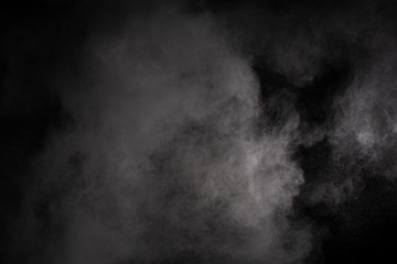 White powder explosion on black background. Colored cloud. Colorful dust explode. Paint Holi.