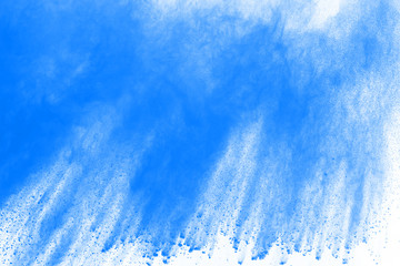 Blue color powder explosion on white background. Colored cloud. Colorful dust explode.