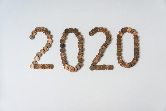 2020 Year made of isolated pennies on blank white background with copyspace